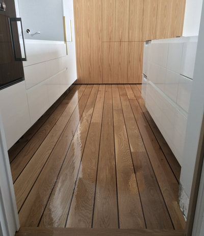 custom flooring for kitchens uses ships decking inspiration for boat style flooring